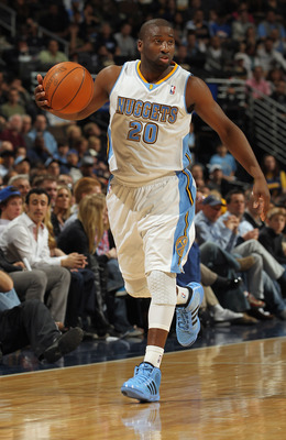 DENVER, CO - MARCH 23:  Raymond Felton #20 of the Denver Nuggets controls the ball against the San Antonio Spurs at the Pepsi Center on March 23, 2011 in Denver, Colorado. The Nuggets defeated the Spurs 115-112. NOTE TO USER: User expressly acknowledges a