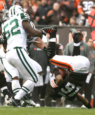 CLEVELAND - NOVEMBER 14:  Wide receiver Joshua Cribbs #16 of the Cleveland Browns flips over as he is hit by linebacker David Harris #52 of the New York Jets at Cleveland Browns Stadium on November 14, 2010 in Cleveland, Ohio.  (Photo by Matt Sullivan/Get