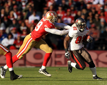 SAN FRANCISCO - NOVEMBER 21:  Micheal Spurlock #81 of the Tampa Bay Buccaneers tries turnover outrun Manny Lawson #99 of the San Francisco 49ers at Candlestick Park on November 21, 2010 in San Francisco, California.  (Photo by Ezra Shaw/Getty Images)