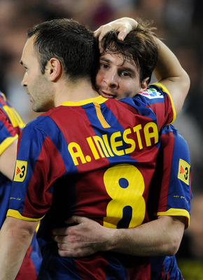 BARCELONA, SPAIN - APRIL 09:  Lionel Messi (R) of Barcelona celebrates his second goal with his teammate Andres Iniesta during the la Liga match between FC Barcelona and UD Almeria at the Camp Nou stadium on April 9, 2011 in Barcelona, Spain.  (Photo by J