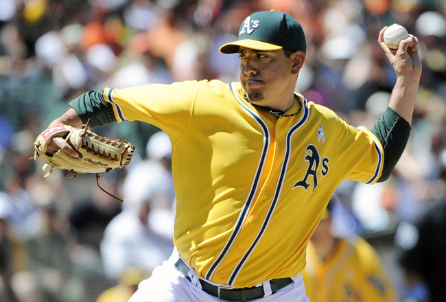 OAKLAND, CA -  JUNE 19: Brian Fuentes #57 of the Oakland Athletics pitches against the San Francisco Giants in the ninth inning during a MLB baseball game June 19, 2011 at the Oakland-Alameda County Coliseum in Oakland, California. The Athletics won the g