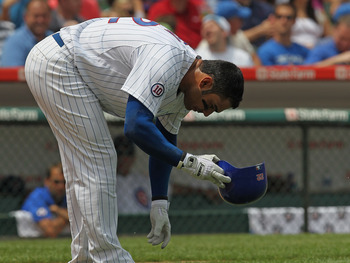 CHICAGO, IL - JULY 16: Carlos Pena #22 of the Chicago Cubs drops his bat and helmut after striking out to end the 4th inning against the Florida Marlins at Wrigley Field on July 16, 2011 in Chicago, Illlinois. (Photo by Jonathan Daniel/Getty Images)