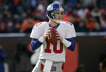CINCINNATI, OH - DECEMBER 26: Quarterback Eli Manning #10 of the New York Giants against the Cincinnati Bengals during the NFL game at Paul Brown Stadium on December 26, 2004 in Cincinnati, Ohio.  The Bengals won 23-22.   (Photo by Andy Lyons/Getty Images