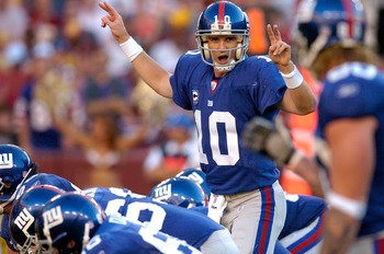 LANDOVER, MD - SEPTEMBER 23:  Eli Manning #10 of the New York Giants calls a play at the line of scrimmage against the Washington Redskins September 23, 2007 at FedEx Field in Landover, Maryland.  (Photo by Greg Fiume/Getty Images)