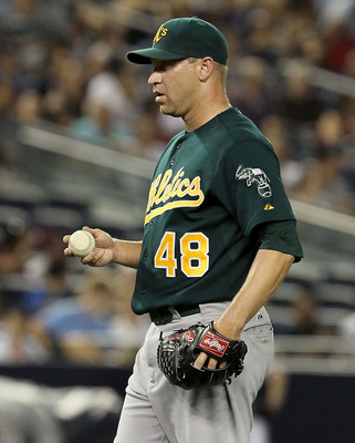 NEW YORK, NY - JULY 22: Michael Wuertz #48 of the Oakland Athletics looks on against the New York Yankees on July 22, 2011 at Yankee Stadium in the Bronx borough of New York City.  (Photo by Jim McIsaac/Getty Images)