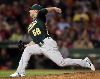BOSTON, MA - JUNE 03:  Craig Breslow #56 of the Oakland Athletics delivers a pitch in the sixth inning against the Boston Red Sox on June 3, 2011 at Fenway Park in Boston, Massachusetts.  (Photo by Elsa/Getty Images)
