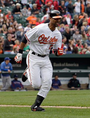 BALTIMORE, MD - APRIL 10: Derrek Lee #25 of the Baltimore Orioles runs to first base against the Texas Rangers at Oriole Park at Camden Yards on April 10, 2011 in Baltimore, Maryland.  (Photo by Rob Carr/Getty Images)