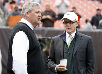 CLEVELAND - NOVEMBER 14:  Head coach Rex Ryan (L) of the New York Jets talks with owner Woody Johnson prior to the start of their game against the Cleveland Browns at Cleveland Browns Stadium on November 14, 2010 in Cleveland, Ohio.  (Photo by Matt Sulliv