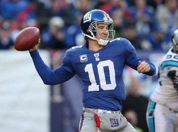 EAST RUTHERFORD, NJ - DECEMBER 27:  Eli Manning #10 of the New York Giants against the Carolina Panthers at Giants Stadium on December 27, 2009 in East Rutherford, New Jersey.  (Photo by Nick Laham/Getty Images)