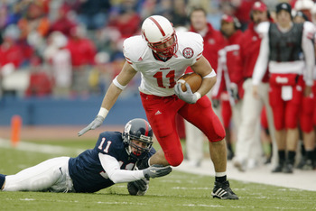 LAWRENCE, KS - NOVEMBER 8:  Tight end Matt Herian #11 of the Nebraska Cornhuskers tries to shed a tackle by Walker Douglas #11 of the Kansas Jay Hawks November 8, 2003 at Memorial Stadium in Lawrence, Kansas.  Nebraska defeated Kansas 24-3. (Photo by Bria