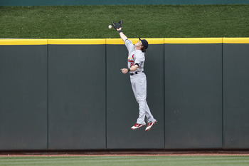 CINCINNATI, OH - MAY 14: Colby Rasmus #28 of the St. Louis Cardinals can't make the catch on a home run ball in the fifth inning by Ramon Hernandez of the Cincinnati Reds at Great American Ball Park on May 14, 2011 in Cincinnati, Ohio. The Reds defeated t