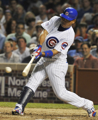 CHICAGO, IL - JULY 18: Kosuke Fukudome #1 of the Chicago Cubs hits a double against the Philadelphia Phillies on July 18, 2011 at Wrigley Field in Chicago, Illinois. The Cubs defeated the Phillies 6-1.  (Photo by David Banks/Getty Images)
