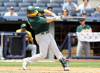 NEW YORK, NY - JULY 23:  Josh Willingham #16 of the Oakland Athletics hits a third inning two run home run against the New York Yankees on July 23, 2011 at Yankee Stadium in the Bronx borough of New York City.  (Photo by Jim McIsaac/Getty Images)