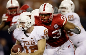 ARLINGTON, TX - DECEMBER 5:  Quarterback Colt McCoy #12 of the Texas Longhorns is sacked by Ndamukong Suh #93 of the Nebraska Cornhuskers in the first quarter of the game at Cowboys Stadium on December 5, 2009 in Arlington, Texas. (Photo by Jamie Squire/G