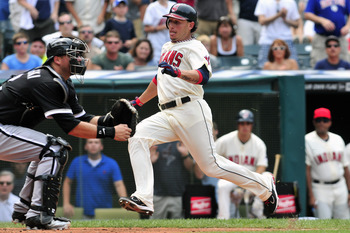 CLEVELAND, OH - JULY 24: Catcher A.J. Pierzynski #12 of the Chicago White Sox waits for the throw as Asdrubal Cabrera #13 slides safely into home off a hit from Travis Hafner #48 (not shown) of the Cleveland Indians during the sixth inning at Progressive