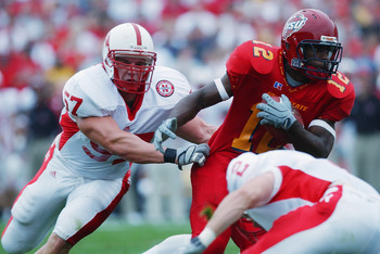 AMES, IOWA - SEPTEMBER 28:  Chris Kelsay #57 of Nebraska tries stop Hiawatha Rutland #12 of Iowa State on September 28, 2002 at Jack Trice Stadium in Ames, Iowa.  Iowa State defeated Nebraska 36-14.  (Photo by Matthew Stockman/Getty Images)