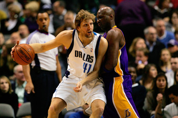 DALLAS - JANUARY 25:  Forward Dirk Nowtizki #41of the Dallas Mavericks moves the ball against Lamar Odom #7 of the Los Angeles Lakers on January 25, 2008 at American Airlines Center in Dallas, Texas.  NOTE TO USER: User expressly acknowledges and agrees t