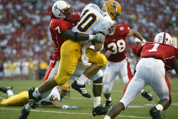 LINCOLN, NE - AUGUST 24:  Linebacker Demorrio Williams #7 of the Nebraska Cornhuskers tackles quarterback Chad Christensen #10 of the Arizona State Sun Devils during the NCAA football game on August 24, 2002, at Memorial Stadium in Lincoln, Nebraska.  Neb