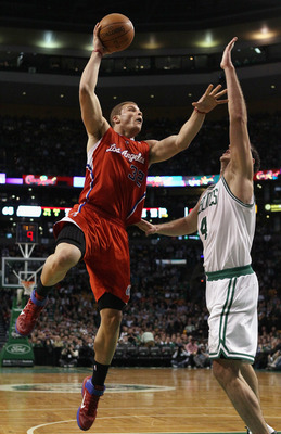 BOSTON, MA - MARCH 09:  Blake Griffin #32 of the Los Angeles Clippers takes a shot as Nenad Krstic #4 of the Boston Celtics defends on March 9, 2011 at the TD Garden in Boston, Massachusetts. The Los Angeles Clippers defeated the Boston Celtics 108-103. N