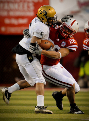 LINCOLN, NE - NOVEMBER 26: Eric Hagg #28 of the Nebraska Cornhuskers brings down Rodney Stewart #5 of the Colorado Buffaloes during the second half of their game at Memorial Stadium on November 26, 2010 in Lincoln, Nebraska. Nebraska defeated Colorado 45-