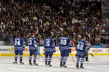 TORONTO - NOVEMBER 18:  Bryan McCabe #24, Alexei Ponikarovsky #23, Tomas Kaberle #15, Nik Antropov #80 and Kyle Wellwood #42 of the Toronto Maple Leafs stand for the National Anthem before the game against the New Jersey Devils at Air Canada Centre on Nov