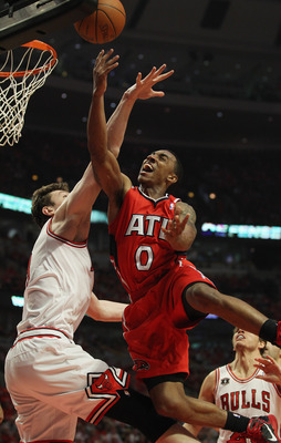 CHICAGO, IL - MAY 10: Jeff Teague #0 of the Atlanta Hawks puts up a shot against Omer Asik #3 of the Chicago Bulls in Game Five of the Eastern Conference Semifinals in the 2011 NBA Playoffs at the United Center on May 10, 2011 in Chicago, Illinois. NOTE T