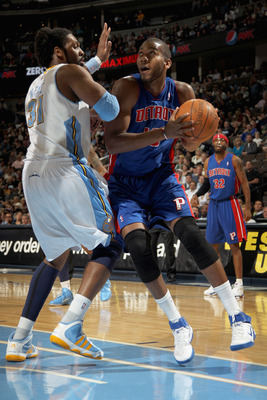DENVER, CO - MARCH 12:  Greg Monroe #10 of the Detroit Pistons goes to the basket against Nene #31 of the Denver Nuggets at the Pepsi Center on March 12, 2011 in Denver, Colorado. The Nuggets defeated the Pistons 131-101.  NOTE TO USER: User expressly ack