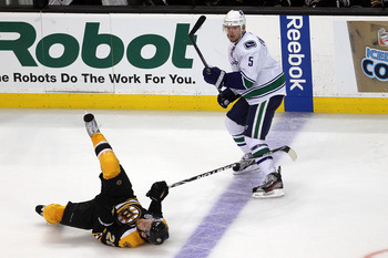 BOSTON, MA - JUNE 08:  Daniel Paille #20 of the Boston Bruins falls to the ice against Christian Ehrhoff #5 of the Vancouver Canucks during Game Four of the 2011 NHL Stanley Cup Final at TD Garden on June 8, 2011 in Boston, Massachusetts.  (Photo by Bruce