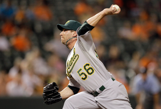 BALTIMORE, MD - JUNE 07: Pitcher Craig Breslow #56 of the Oakland Athletics delivers to a Baltimore Orioles batter at Oriole Park at Camden Yards on June 7, 2011 in Baltimore, Maryland.  (Photo by Rob Carr/Getty Images)