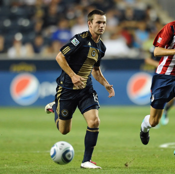 CHESTER, PA - SEPTEMBER 01:  Jack McInerney #19 of the Philadelphia Union and Jorge Enriquez #14 of Chivas de Guadalajara race for the ball at PPL Park on September 1, 2010 in Chester, Pennsylvania. McInerney went on to score and give the Union a 1-0 vict