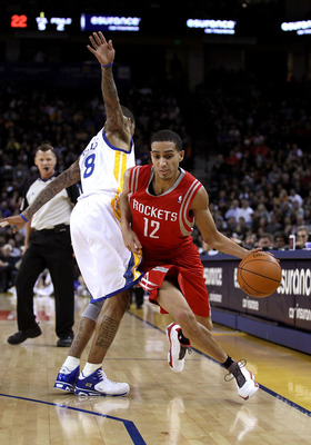OAKLAND, CA - DECEMBER 20:  Kevin Martin #12 of the Houston Rockets dribbles around Monta Ellis #8 of the Golden State Warriors at Oracle Arena on December 20, 2010 in Oakland, California. NOTE TO USER: User expressly acknowledges and agrees that, by down