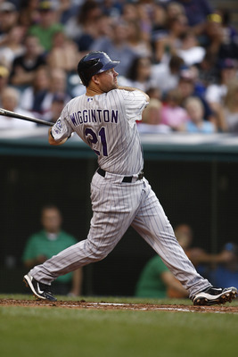 CLEVELAND, OH - JUNE 22:  Ty Wigginton #21 of the Colorado Rockies connects for a homerun during the game against Cleveland Indians on June 22, 2011 at Progressive Field in Cleveland, Ohio.  The Cleveland Indians defeated the Colorado Rockies 4-3. (Photo