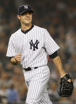 NEW YORK - MAY 21:  David Robertson #30 of the New York Yankees pumps his fist after the last out if the seventh inning during their game against New York Mets on May 21, 2011 at Yankee Stadium in the Bronx borough of New York City. Yankees defeat the Met