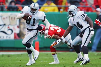 KANSAS CITY, MO - OCTOBER 27:   Wide Receiver Tim Brown #81 of the Oakland Raiders advances the ball during the NFL game against the Kansas City Chiefs at Arrowhead Stadium on October 27, 2002 in Kansas City, Missouri.  The Chiefs defeated the Raiders 20-