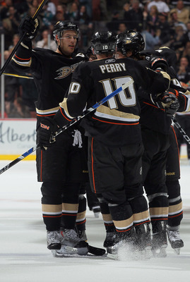 ANAHEIM, CA - APRIL 06:  Ryan Getzlaf (L) #15 and Corey Perry#10 of the Anaheim Ducks celebrate Cam Fowler's second period goal against the San Jose Sharks at Honda Center on April 6, 2011 in Anaheim, California.  (Photo by Jeff Gross/Getty Images)