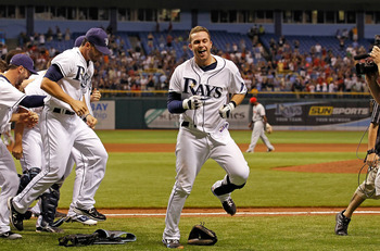 ST. PETERSBURG, FL - JUNE 28:  Infielder Evan Longoria #3 of the Tampa Bay Rays celebrates his walk off home run against the Cincinnati Reds during the game at Tropicana Field on June 28, 2011 in St. Petersburg, Florida.  (Photo by J. Meric/Getty Images)