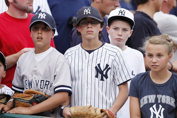 CINCINNATI, OH - JUNE 22: A group of young New York Yankees fans look on before the second game of a doubleheader against the Cincinnati Reds at Great American Ball Park on June 22, 2011 in Cincinnati, Ohio. (Photo by Joe Robbins/Getty Images)