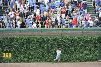 CHICAGO, IL - JULY 22:  Center fielder Michael Bourn #21 of the Houston Astros watches a two-run home run hit by Aramis Ramirez #16 of the Chicago Cubs leave the park during the fifth inning at Wrigley Field on July 22, 2011 in Chicago, Illinois. Carlos Z