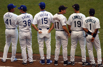 MILWAUKEE, WI - JULY 9:  National League All Stars Odalis Perez #41, Eric Gagne #38, Shawn Green #15 (Los Angeles Dodgers), Lance Berkman #17 (Houston Astros), Mike Lowell #19 and Luis Castillo #1 (Florida Marlins) stand on the field during introductions