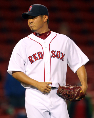 BOSTON, MA - MAY 04:  Daisuke Matsuzaka #18 of the Boston Red Sox reacts after giving up a single to Peter Bourjos #25 of the Los Angeles Angels of Anaheim in the 13th inning at Fenway Park on May 4, 2011 in Boston, Massachusetts. (Photo by Jim Rogash/Get
