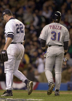 22 Oct 2000:  Pitcher #22 Roger Clemens (left) of the New York Yankees and#31 Mike Piazza of the New York Mets cross paths in the sixth inning during Game 2 of the MLB World Series at Yankee Stadium in the Bronx, New York. <DIGITAL IMAGE> Mandatory Credit