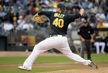 OAKLAND, CA - JULY 16: Andrew Bailey #40 of the Oakland Athletics pitches against the Los Angeles Angels of Anaheim in the ninth inning of game two of a double header at the O.co Coliseum July 16, 2011 in Oakland, California. The Athletics won the game 4-