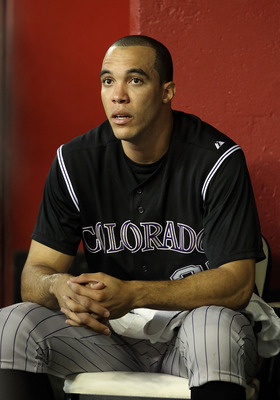 PHOENIX, AZ - JULY 24:  Starting pitcher Ubaldo Jimenez #38 of the Colorado Rockies watches from the dugout during the Major League Baseball game against the Arizona Diamondbacks at Chase Field on July 24, 2011 in Phoenix, Arizona.  (Photo by Christian Pe
