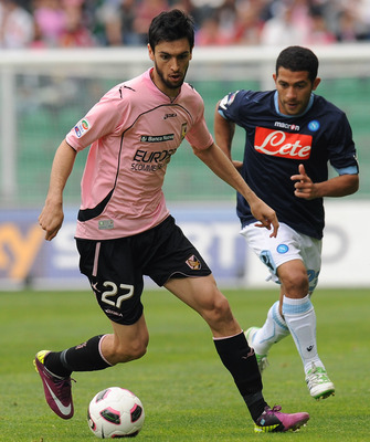 PALERMO, ITALY - APRIL 23:  Javier Pastore (L) of Palermo holds off the challenge from Walter Gargano of Napoli during the Serie A match between US Citta di Palermo and SSC Napoli at Stadio Renzo Barbera on April 23, 2011 in Palermo, Italy.  (Photo by Tul