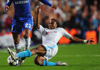 LONDON, ENGLAND - SEPTEMBER 28:  Daniel Sturridge of Chelsea is tackled by Andre Ayew of Marseille during the UEFA Champions League Group F match between Chelsea and Marseille at Stamford Bridge on September 28, 2010 in London, England.  (Photo by Mike He