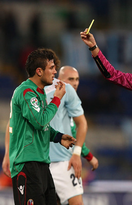 ROME - NOVEMBER 29:  Referee Bergonzoni (R) shows the yellow card to Stefan Radu (L) of SS Lazio and to Pablo Daniel Osvaldo (C) of Bologna during the Serie A match between SS Lazio and Bologna FC at Stadio Olimpico on November 29, 2009 in Rome, Italy.  (
