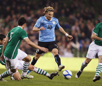 DUBLIN, IRELAND - MARCH 29:  Darren O'Dea of Republic of Ireland tries to tackle Diego Forlan of Uruguay during the International Friendly match between Republic of Ireland and Uruguay at the Aviva Stadium on March 29, 2011 in Dublin, Ireland.  (Photo by