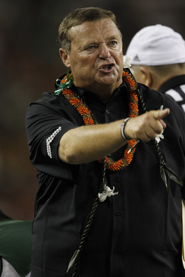 HONOLULU - SEPTEMBER 2:  Head Coach Greg McMackin of the University of Hawaii Warriors exchanges words with game officials during second half action at Aloha Stadium September 2, 2010 in Honolulu, Hawaii. (Photo by Kent Nishimura/Getty Images)