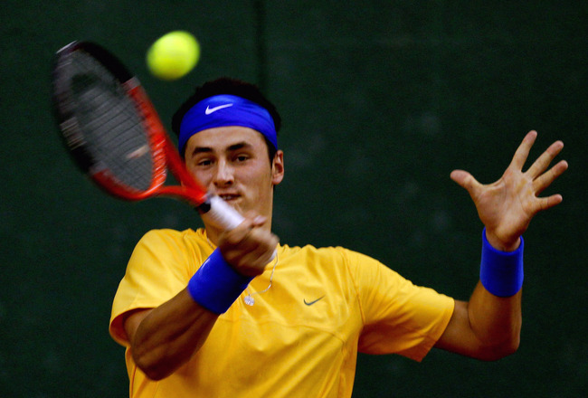 BEIJING, CHINA - JULY 08: Bernard Tomic of Australia in action against Zhang Ze of China during day one of the 2011 Davis Cup on July 8, 2011 in Beijing, China. (Photo by Lintao Zhang/Getty Images)