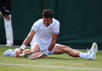 LONDON, ENGLAND - JUNE 22:  Milos Raonic of Canada falls down during his second round match against Gilles Muller of Luxembourg on Day Three of the Wimbledon Lawn Tennis Championships at the All England Lawn Tennis and Croquet Club on June 22, 2011 in Lon